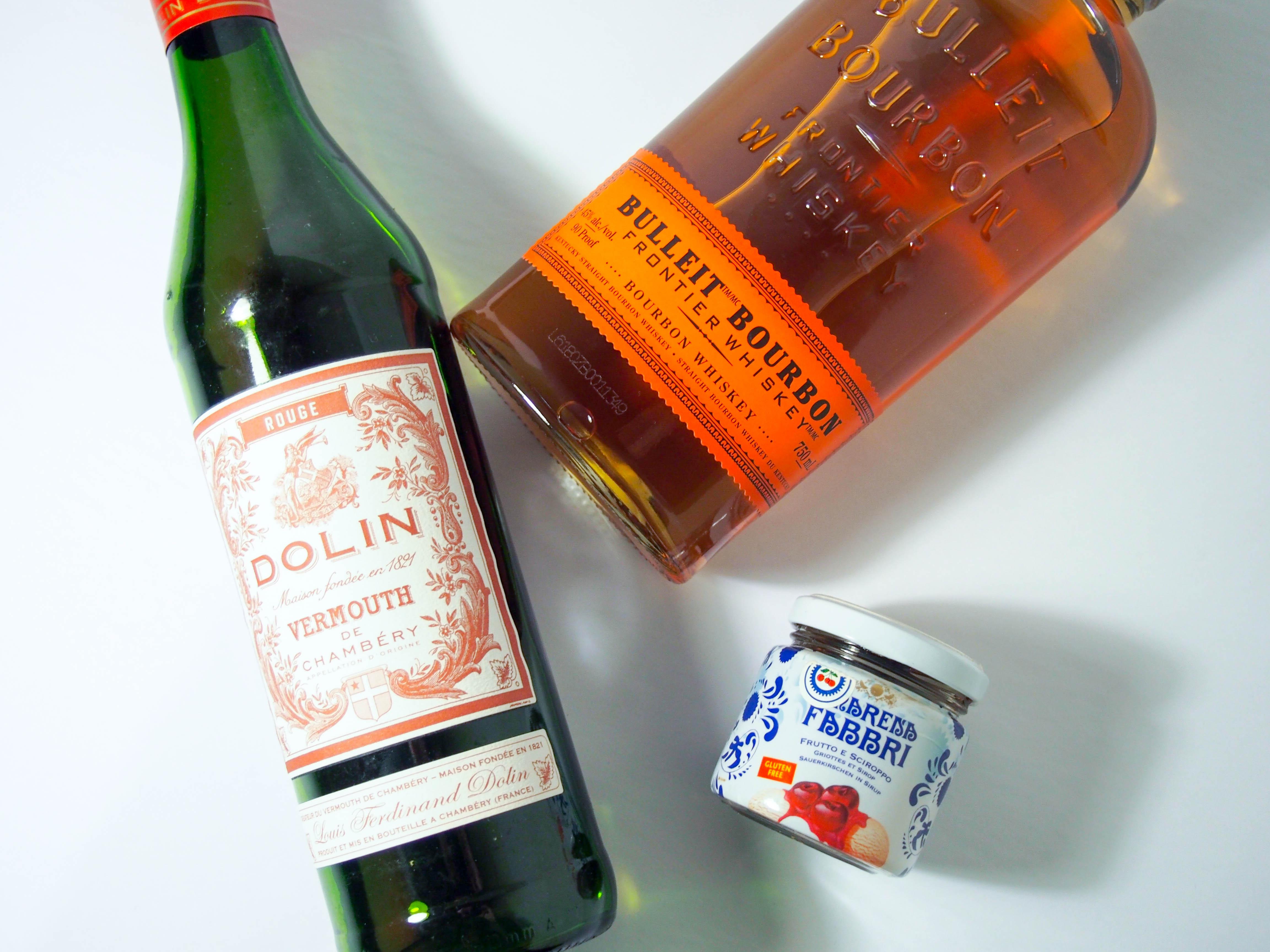 Manhattan Cocktail Ingredients: Dolin Vermouth, Bulliet Bourbon and Amerena Cherries